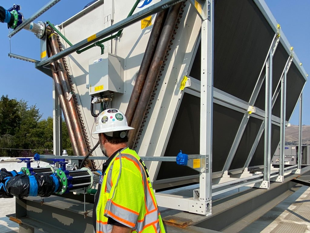 Worker installing equipment
